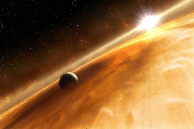 Planet surrounded by dust and bright star in background.