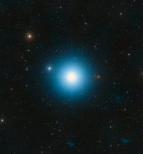 Bright bluish star with many more stars in background.