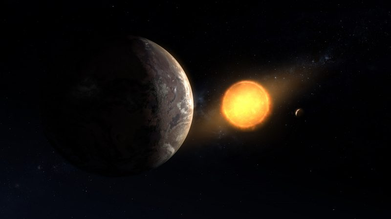 Two planets orbiting a bright star with other stars in background.