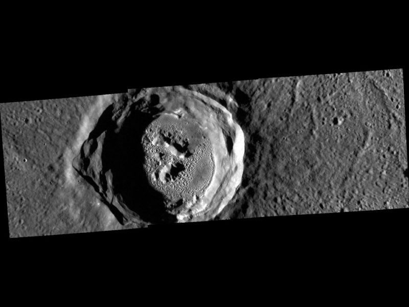A single crater with depressions and textured surface in it.
