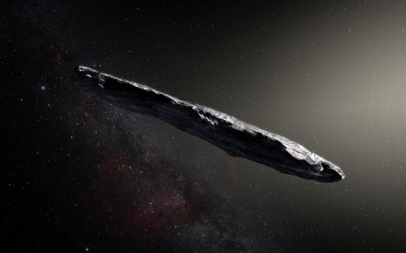 Long thin rocky object in space with stars in background.