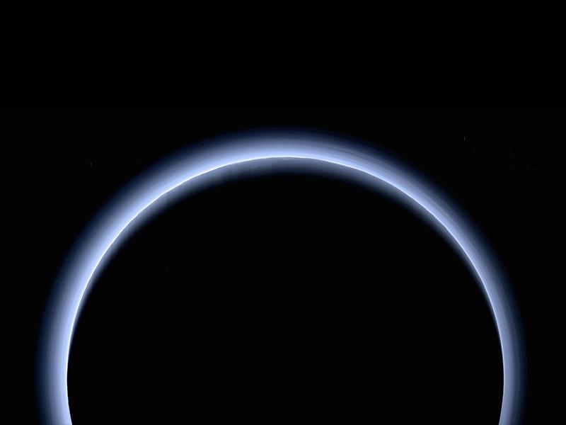Fuzzy blue ring around black circle on black background.