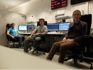 Spaceflight controllers observing social distancing during flyby.