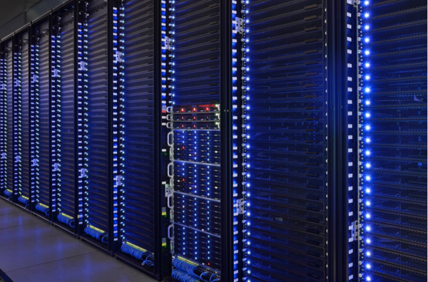 An array of many identical tall box-like computers, with blue lights.