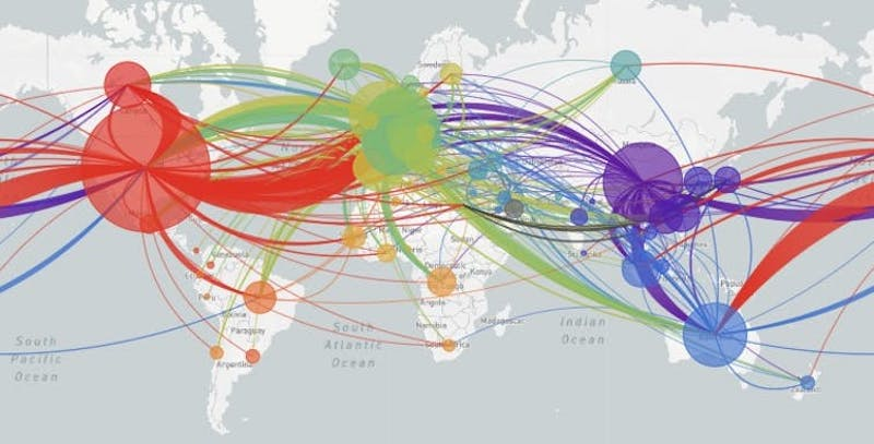 Map of the world with large circles at pandemic hot spots and criss-crossed with multi-colored lines.