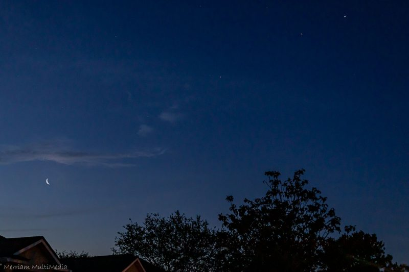 Waning crescent moon and a little arc of 3 planets.