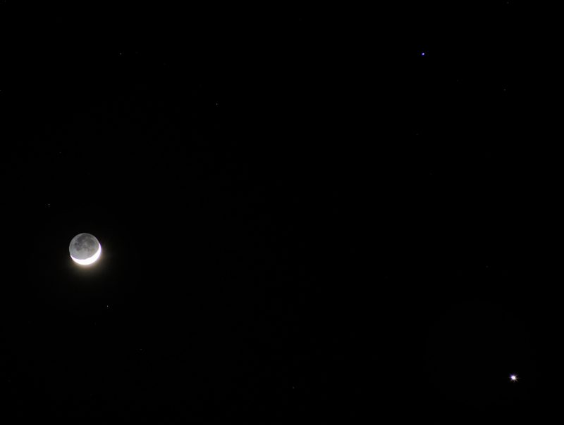 Crescent moon, a fainter star and a bright planet.