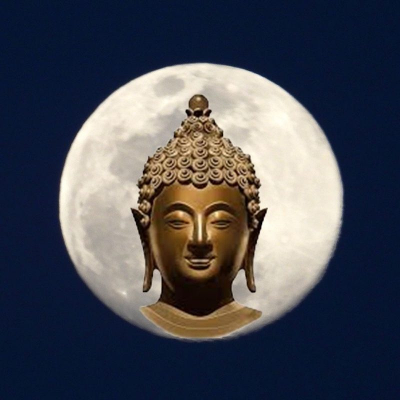 The May 2020 supermoon with the face of Buddha superimposed upon it.