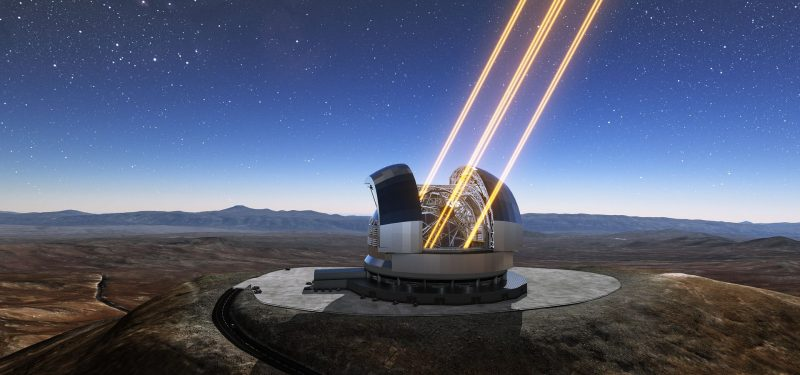 Open domed observatory with large telescope shooting lasers into dark blue sky with stars.