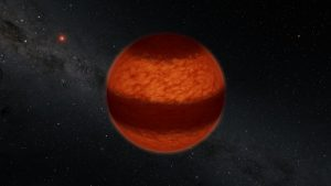 Reddish globe with a wide dark band, and stars in background.