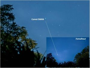 A comet in a twilight sky.