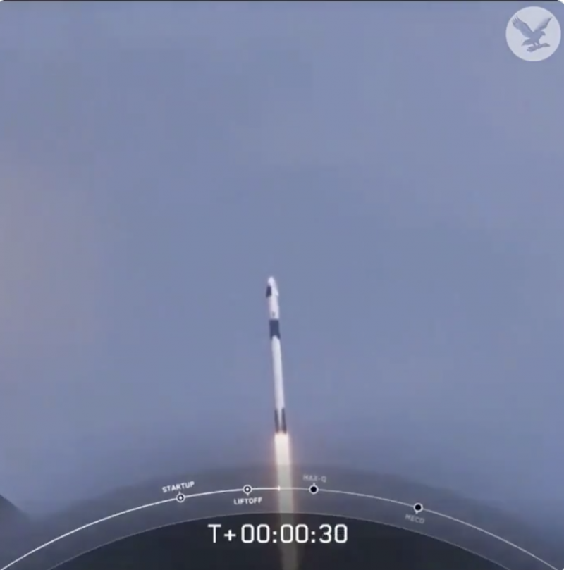 A tall rocket blasting into Earth orbit on a long tail of white-hot flame.