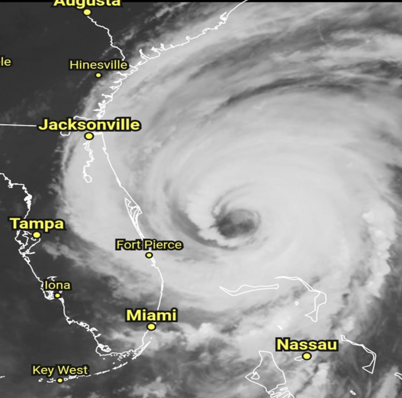 Orbital view of giant round storm with deep eye, around the time it's making landfall in the Bahamas.