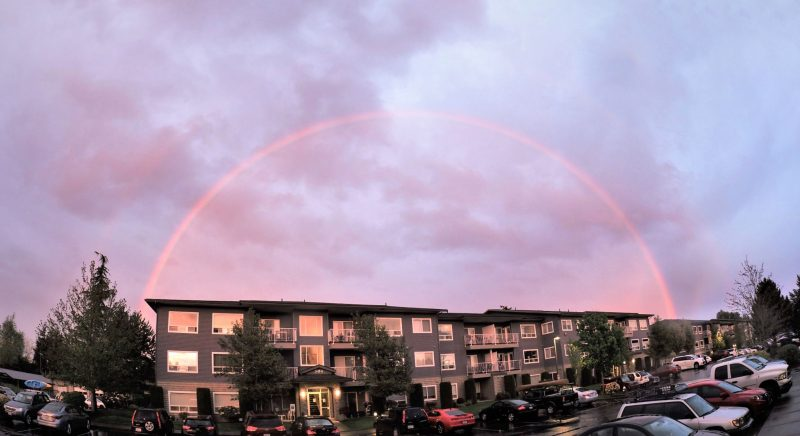 Double rainbow over what looks like an apartment complex.