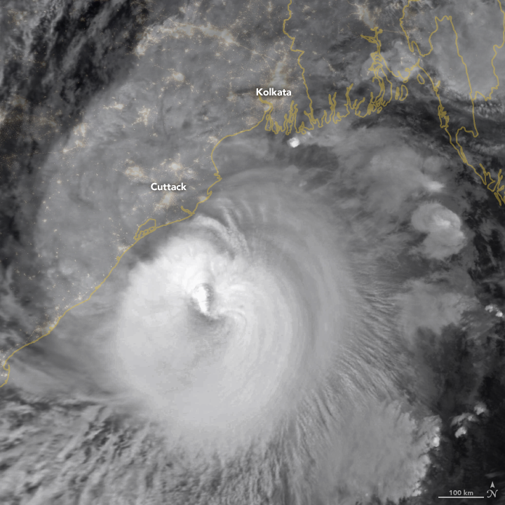 A large hurricane, or tropical cyclone, approaching India from the east with coastline outlined.