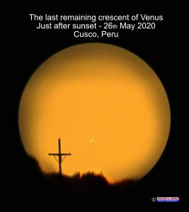 Venus through a telescope, in a mosaic, it looks like, with a cross on a ridgeline.