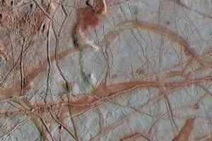 Light-colored terrain with many brown cracks and streaks.