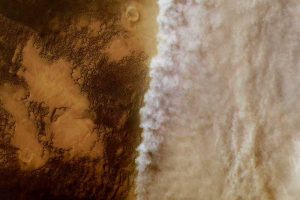 Brownish terrain on left and cloud-like patterns on right.
