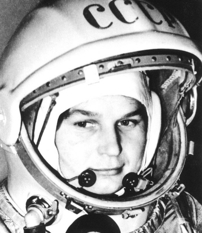 Closeup of young woman in space helmet, black and white, with CCCP on the helmet.