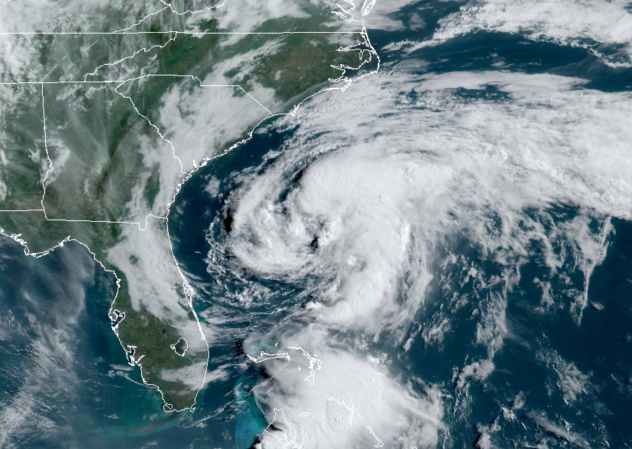 Orbital view of white spiral over ocean next to South Carolina, Georgia, and Florida.