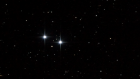 Image of a star field showing two bright stars, Epsilon Lyrae 1 and Epsilon Lyrae 2.