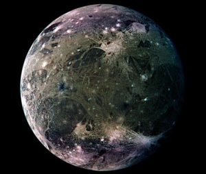 Colorful marble-like moon on black background.