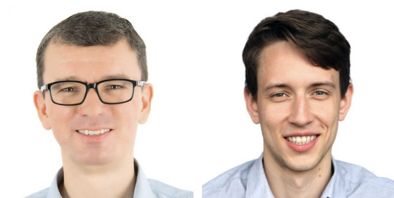 Two smiling young men side-by-side on white background.