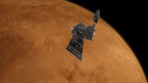 Satellite orbiting reddish Mars.