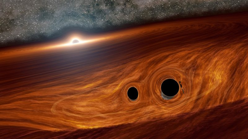 Swirly red disk with distant black sphere, and 2 more black spheres, one slightly bigger, in foreground