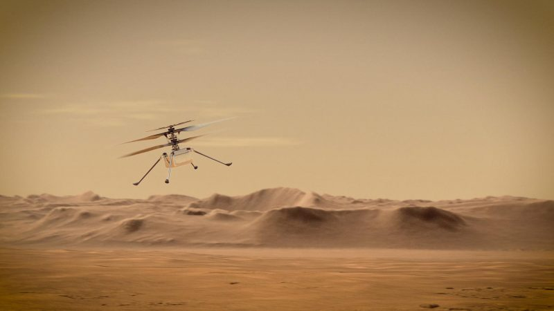 Device with four spidery legs and two rotors flying above reddish Martian landscape.