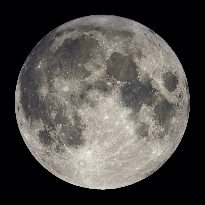 Large full moon, with almost invisible shadow.