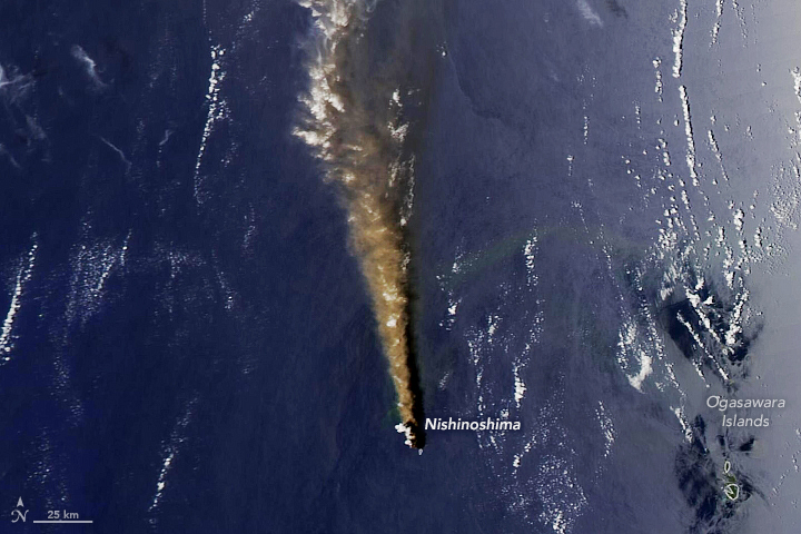 Orbital view of dark blue sea with a brown stripe of a billowing plume of smoke.