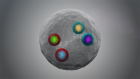 A gray ball with 4 brightly colored circles inside it.
