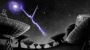 Jagged beam of light coming from a galaxy to a cluster of radio telescopes.