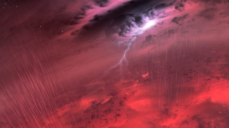 Lightning and rain in a turbulent reddish atmosphere above mottled red glowing landscape.