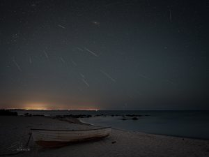 Composite photos of meteors raining down from above.
