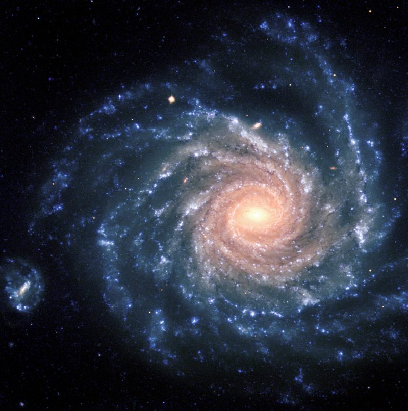Bluish spiral with many clumpy arms and bright yellow-pink center.