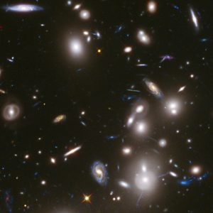 A cluster of galaxies, seen through a large telescope.