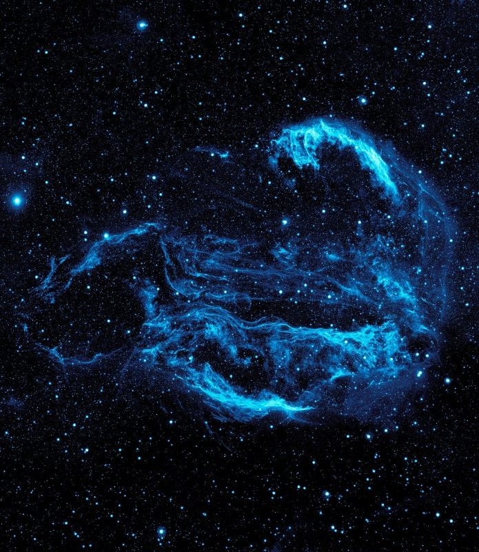 Strands of glowing blue gases forming a roughly spherical shape in space with many stars in background.