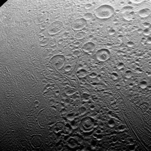 Grayish moon covered in craters.