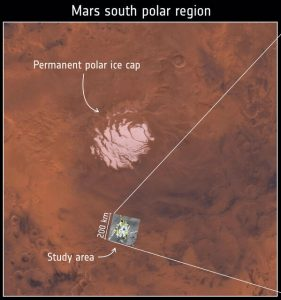 White patch in brownish terrain with white lines and text annotations.