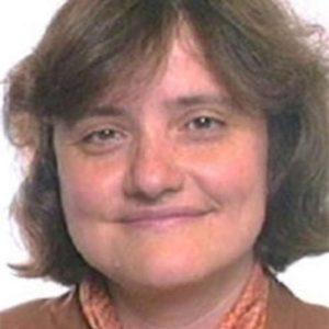 Smiling woman headshot on white background.