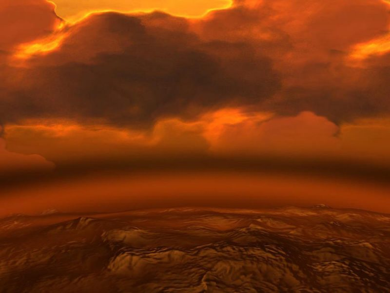 Thick reddish clouds over dark reddish rocky surface.