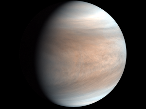Planet covered by wispy clouds on black background.