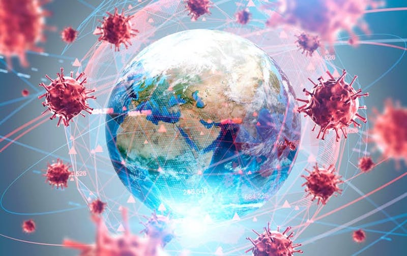 Globe of Earth surrounded by enlarged red viruses.
