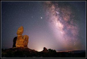 Jupiter, Saturn, Milky Way, zodiacal light, with Balanced Rock in the foreground.