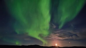 Moon and Mars rising above a ridgeline, with a glorious display of northern lights in the background.