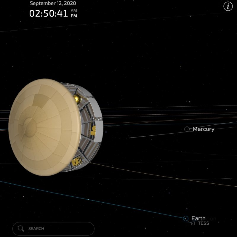 Drum-shaped spacecraft in space with orbits of planets shown in background.