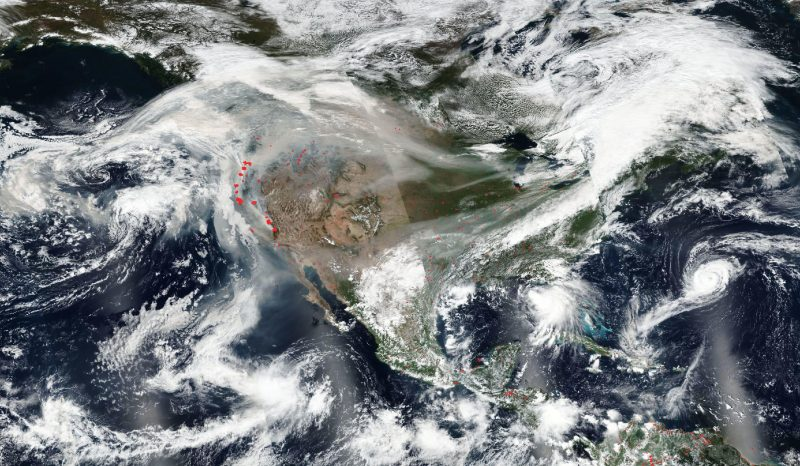 Orbital view of North America with gray streaks from west to east.