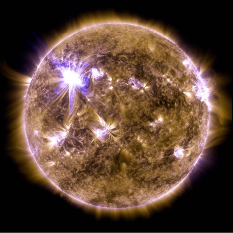 A close-up image of the sun with a large flare on one portion.